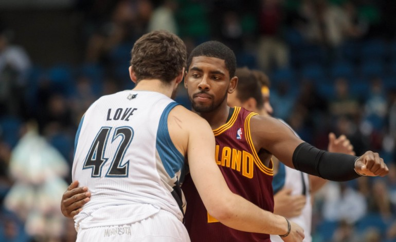Kevin Love hugs Kyrie Irving